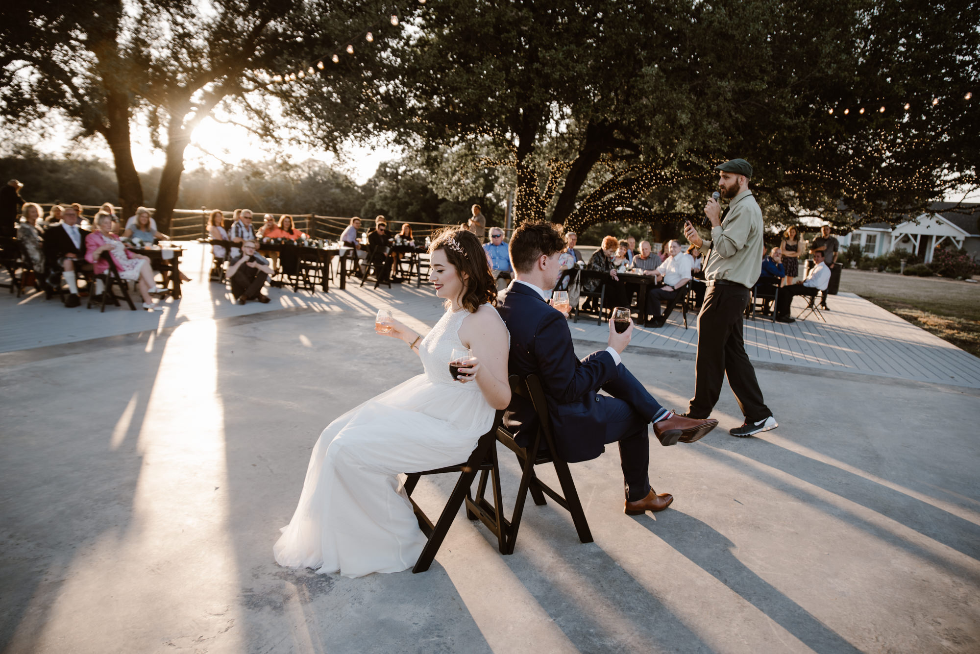 Brid And Groom Playing A Drinking At Their Wedding Reception Texas Photographer